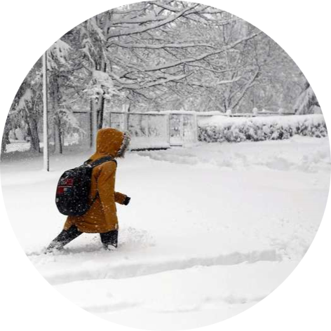 child in Poland crossing through high snow with backpack